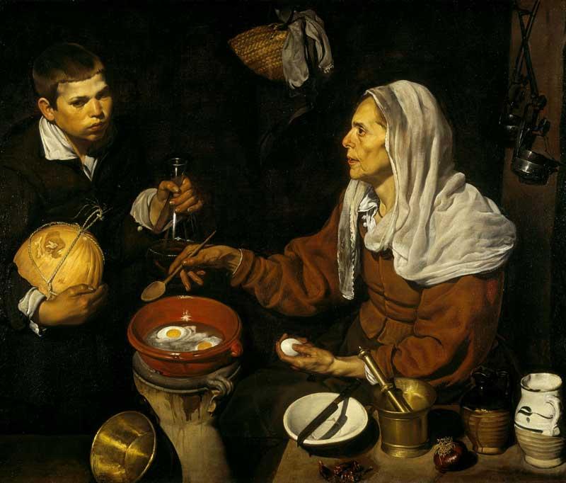 پیرزن در حال سرخ کردن تخم مرغ